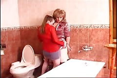 Russian teen lesbian seduces a mature woman in bathroom